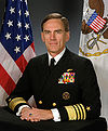 Man sitting in US Navy admiral's dress uniform