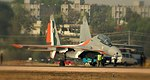 Aero India 2009 - Sukhoi 30 MKI , Size does matter - you can see the ground officers and the Toyota quallis parked nearby and get an idea of the size of the aircraft that is capable of carrying the Brahmos missile underneath its belly!!.jpg