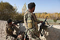 Afghan National Army Soldiers scan a tree line at the support by fire position while patrolling the village of Mangokher during Operation Shamshir, in Kherwar District, Logar province, Afghanistan, Oct. 21 111021-A-ZI978-015.jpg