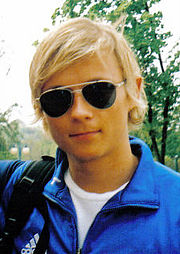 A young man with blond hair.