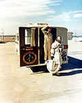 Alan Shepard examines weather conditions as he walks from the transfer van.jpg