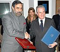 Anand Sharma and the Italian Minister for Economic Development, Mr. Claudio Scajola exchanging the signed documents of the Minutes of Indo-Italian Joint Commission for Economic Cooperation, in New Delhi on December 14, 2009.jpg