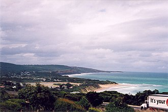Anglesea, Victoria - Anglesea, including the tidal river mouth, seen from a lookout above the Great Ocean Road. Coastal points of interest visible in this picture are Main Beach, which is home to the Anglesea Surf Life Saving Club, and Point Addis, in the background.