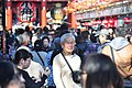Asakusa - people leaving Senso-ji 14 (15763013202).jpg