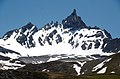 At the South side of the valley dominates this impressive peak Aiguille du Dome 3017 m the Park - panoramio.jpg