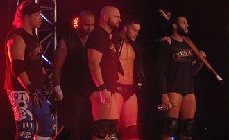 Tama Tonga - Tonga (far right) with Bullet Club in September 2013