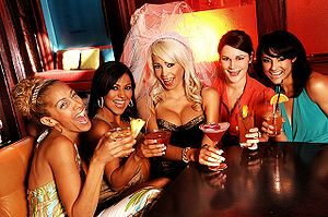 Bride-to-be (center) and friends share a toast...