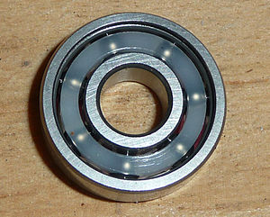 Ball bearing - A ball bearing for skateboard wheels with a plastic cage
