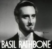 Basil Rathbone in Tovarich trailer.jpg