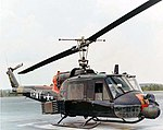 Bell UH-1 with rockets and minigun turret.jpg