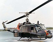 Bell UH-1 with rockets and minigun turret