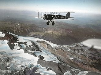 Boeing Model 40 - A Boeing Model 40 flying over mountains in Washington State, 1930s.