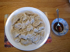 Jiaozi - A plate of boiled dumplings (shuijiao) and sauce