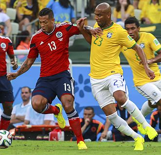 Fredy Guarín - Guarín (left) playing for Colombia at the 2014 FIFA World Cup