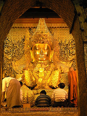 Makuṭa - The Mahamuni Buddha image in Mandalay is crowned with a crested magaik bejewelled with diamonds, rubies and sapphires.