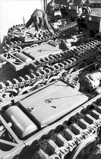 Sd.Kfz. 11 - Sd.Kfz. 11 chassis shown at the factory. From left, the muffler, fuel tank and transmission are visible