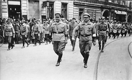 Communist Party (KPD) leader Ernst Thalmann (person in foreground with raised clenched fist) and members of the Roter Frontkampferbund (RFB) marching through Berlin-Wedding, 1927 Bundesarchiv Bild 183-Z0127-305, Berlin 1927, Reichstreffen RFB, Thalmann, Leow.jpg