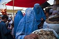 Burqa clad women bying at a market.jpg
