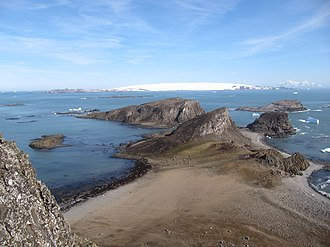 Smith Island (South Shetland Islands) - Smith Island on the horizon on the right, seen from Lucifer Crags on Byers Peninsula, Livingston Island, with Devils Point and Hell Gates in the foreground and Morton Strait and Snow Island in the background