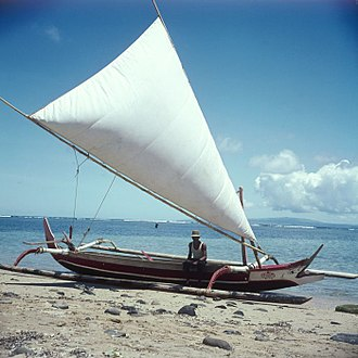 Proa - Proa with hoisted sail at the beach, circa 1970