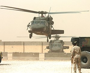 English: UH-60 Blackhawk helicopters take off ...