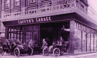 Caffyns - The first garage, at 12 The Colonnade, Eastbourne in 1904. Mr H.B. Caffyn is on the left, Mr P.T. Caffyn in the centre.