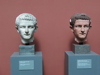 Roman sculpture - Marble bust of Caligula, Roman emperor AD 37–41, with traces of original paint beside a plaster replica trying to recreate the polychrome traditions of ancient sculpture. Exhibition in Ny Carlsberg Glyptotek in Copenhagen, Denmark.