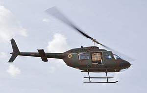 Cameroon Air Force - A Cameroonian Bell 206 flies over Koutaba during training on Pathfinder 2014
