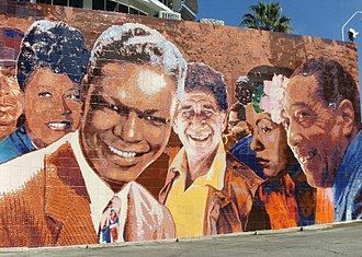 """Richard Wyatt Jr. - Entitled """"Hollywood Jazz: 1945-1972"""" at Capitol Records in Los Angeles, CA. Restored in hand-glazed ceramic tile, the mural is 26ft. by 88ft. This masterpiece entails """"larger than life"""" images of: Chet Baker, Gerry Mulligan, Charlie """"Bird"""" Parker, Tito Puente, Miles Davis, Ella Fitzgerald, Nat King Cole, Shelly Manne, Dizzy Gillespie, Billie Holiday, and Duke Ellington."""