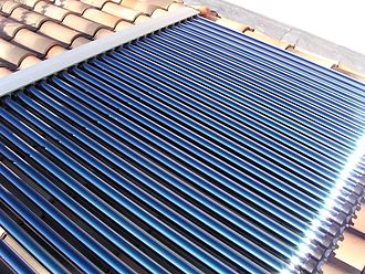 Emissivity - Solar water heating system based on evacuated glass tube collectors. Sunlight is absorbed inside each tube by a selective surface. The surface absorbs sunlight nearly completely, but has a low thermal emissivity so that it loses very little heat. Ordinary black surfaces also absorb sunlight efficiently, but they emit thermal radiation copiously.