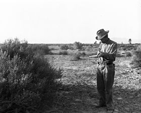 Carl Eytel, artist, sketching on his pad during his trip with George Wharton James to the Colorado River, ca.1900 (CHS-4299).jpg