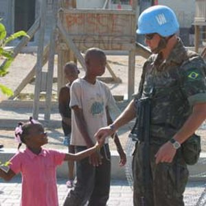 United Nations Stabilisation Mission in Haiti - Brazilian MINUSTAH soldier with a Haitian girl in February 2005