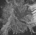 Casement Glacier, braided outwash delta nd valley glacier terminus half covered in rocks, August 24, 1963 (GLACIERS 5275).jpg