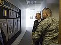 Chairman of the Joint Chiefs of Staff U.S. Army Gen. Martin E. Dempsey, center, views a display at the Center for the Army Profession and Ethic while visiting the U.S. Military Academy at West Point, N.Y 140327-D-HU462-063.jpg