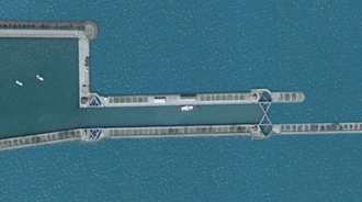 Chicago Harbor Lock - Satellite view of the Chicago Harbor Lock separating the Chicago River (left) from Lake Michigan (right).  The west gate is open and the east gate is closed putting the lock chamber at the level of the river.