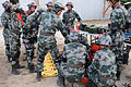 Chinese service members demonstrate disaster management techniques to U.S. Service members during Disaster Management Exchange 2013 at the U.S. Marine Corps Training Area Bellows, Marine Corps Base Hawaii 131112-A-NV268-008.jpg