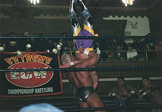Chris Candido - Candido performing a delayed vertical suplex on Jerry Lynn in 1998.