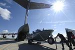 Coast Guard crews prepare boat for transport on C-17 DVIDS1094461.jpg