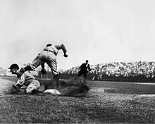 Ty Cobb stealing 3rd base in a game in 1910