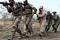 Combined U.S. and African forces move to clear a building during urban combat techniques training July 13, 2012, in Thies, Senegal 120713-M-ZR240-029.jpg