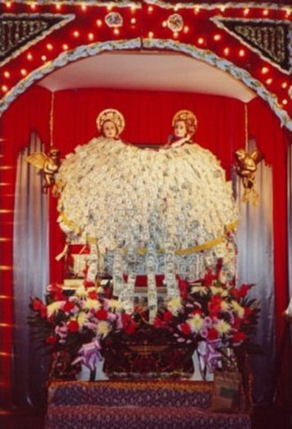 Feast of Saints Cosmas and Damian - Statues of Saints Cosmas and Damian are covered in money by the end of the feast each year