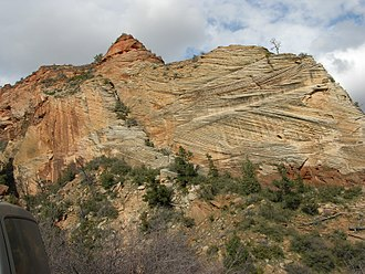 Cross-bedding - Crossbedding of sandstone near Mt. Carmel road, Zion Canyon, indicating wind action and sand dune formation had occurred prior to formation of the rock.