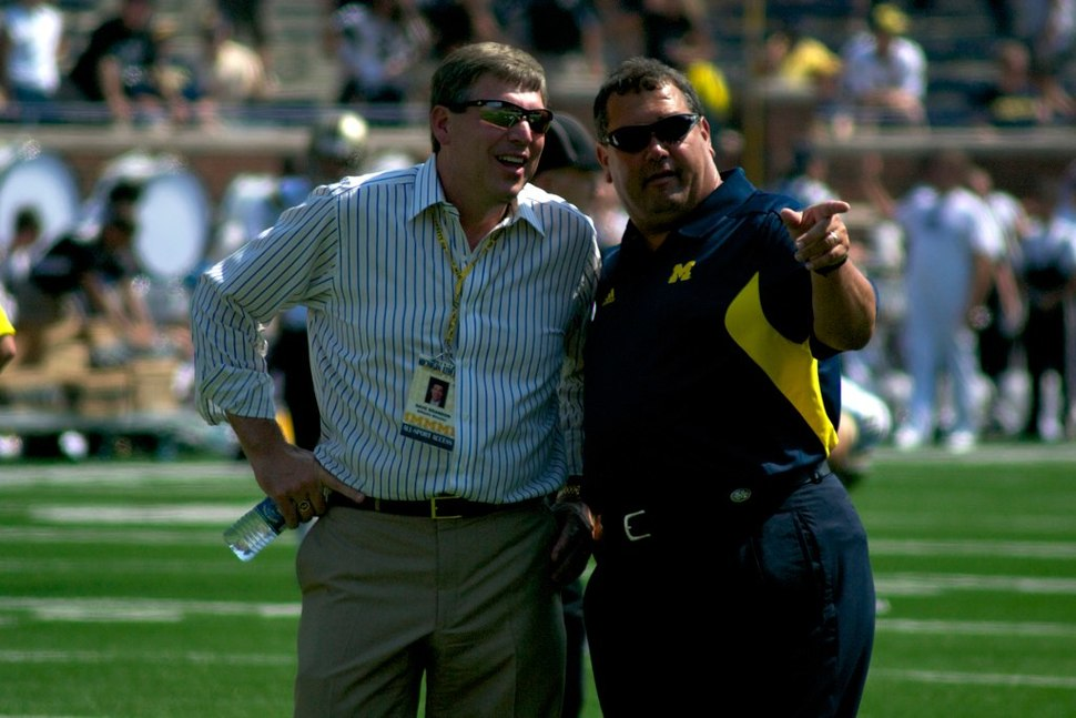 Dave Brandon and Brady Hoke Pointing