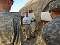 David Annas, an engineering manager for the contractor Saab Barracuda, explains a Solar Shade System to U.S. Soldiers assigned to Bravo Company, 2nd Battalion, 34th Armor Regiment, at Camp Beuhring, Kuwait 140710-A-VT075-182.jpg