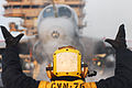 Defense.gov News Photo 110329-N-SB672-196 - U.S. Navy Airman Ryan Hilliard directs an EA-6B Prowler on to catapult one before launching off the flight deck of the aircraft carrier USS Ronald.jpg