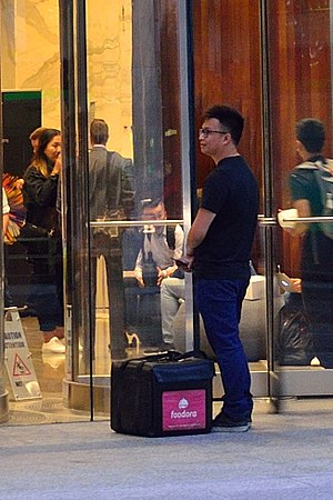 Foodora - Foodora delivery man outside of a commercial office.