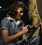 Detail, Riveter at work on Consolidated bomber, Consolidated Aircraft Corp. 1a34953v (cropped).jpg