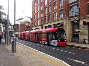 Lace Market tram stop - Tram in diamond jubilee livery at Lace Market tram stop