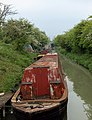 Dilapidated narrowboats moored near Grand Union Canal Leamington Spa.jpg