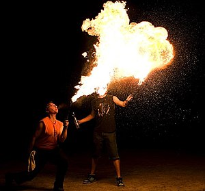 Fire breathing - Dragon's breath, where the fire breather continues to feed a full-sized flame